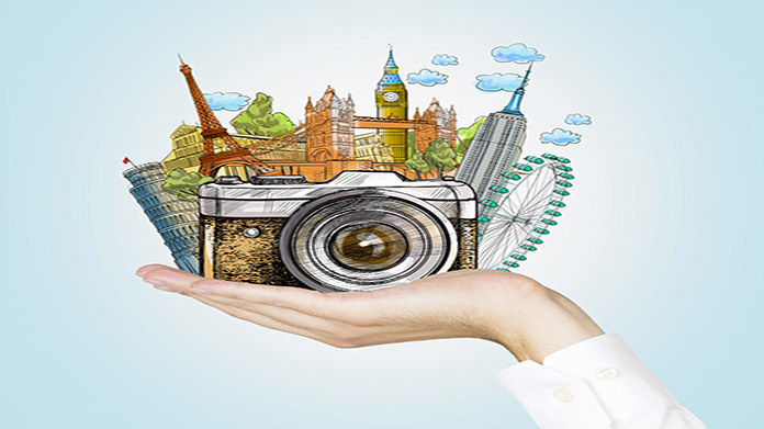 Illustrated hand cradling camera and famous european landmarks