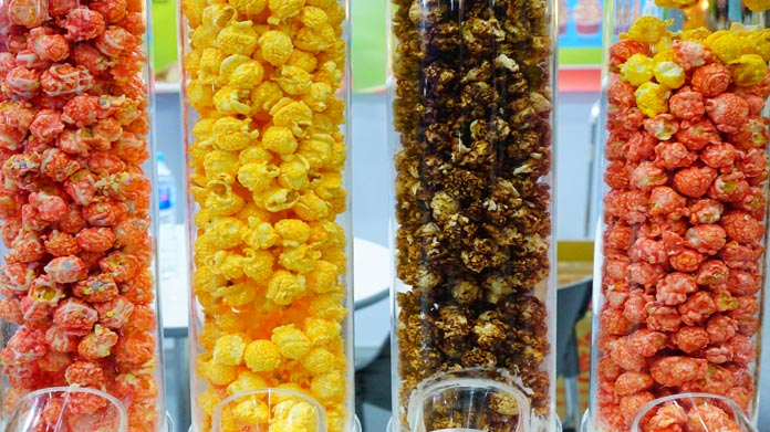 Dispensers full of different types of popcorn