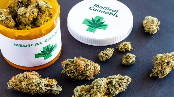 An open pill container containing medical cannabis on a table