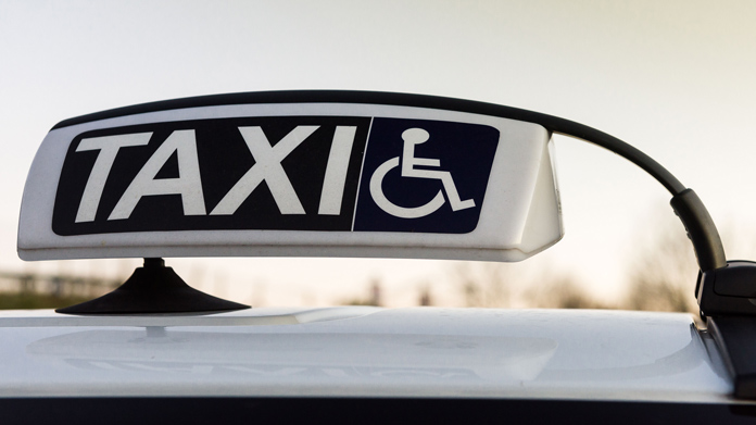 https://cdn2.howtostartanllc.comA close-up of a taxi sign