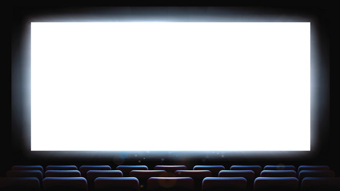 A blank white screen in an empty theater