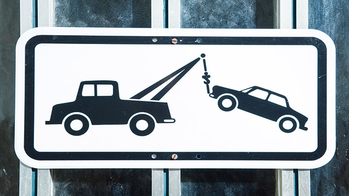 https://cdn2.howtostartanllc.comA black and white sign with a tow truck company