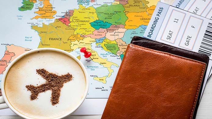 A map of Europe with a plane ticket and a cup of coffee