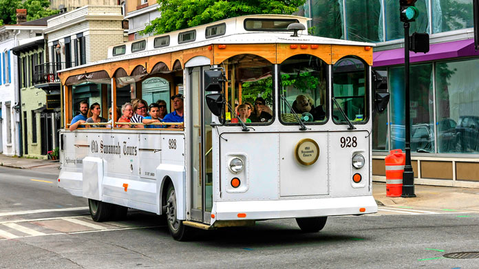 White tour trolley with passengers
