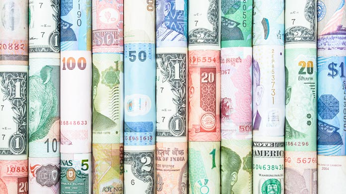 https://cdn2.howtostartanllc.comSeveral rolled bills of international currency