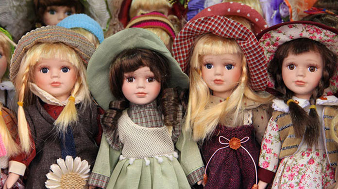Row of dolls in various outfits