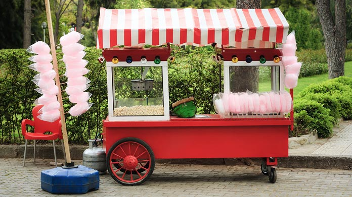 https://cdn2.howtostartanllc.comA food kiosk with popcorn and cotton candy