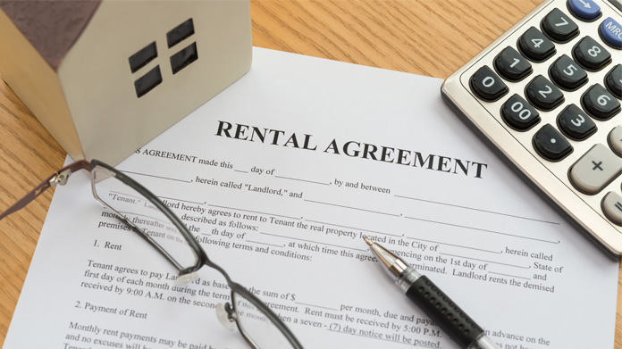 A rental agreement paper sitting on a table