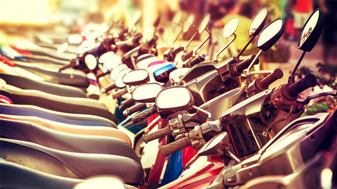 https://cdn2.howtostartanllc.comA close up photo of many motorscooters in a line