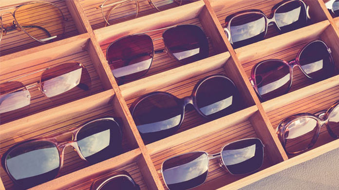 Sunglasses displayed on a wooden display case