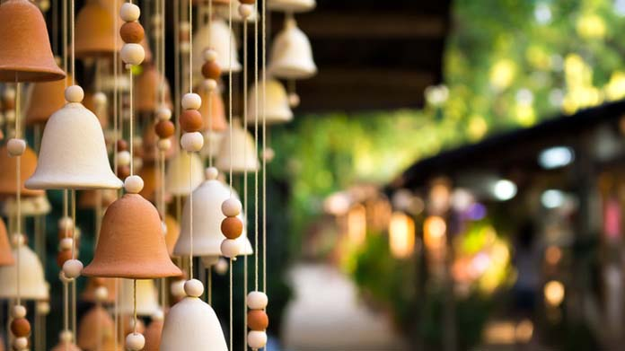 Clay wind chimes hanging in a market
